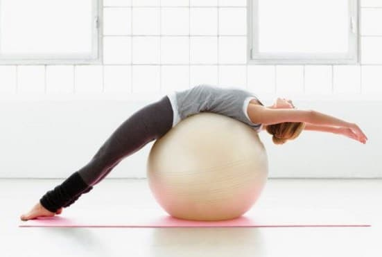 7 Back Exercises You Can Do With An Exercise Ball